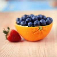 An orange of Blueberries by cloduy