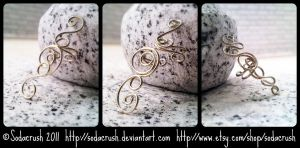 Silver Swirl Ear Cuffs by sodacrush