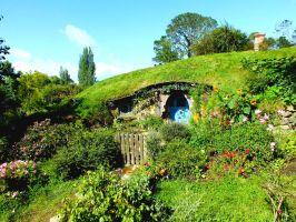 The blue Hobbit hole by Cosmic-Empress