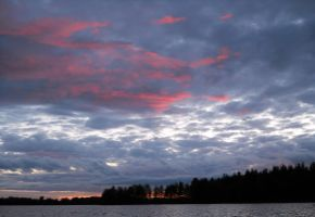 pink clouds in Finland by HoneyMuffins