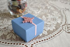 Pale blue origami gift box with quilling ornament by ReverseCascade