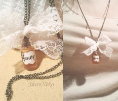 Bottle pendant with honey :3 by ShirNek0