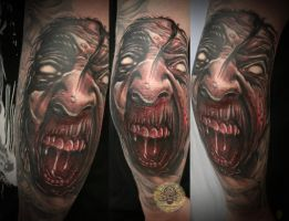 Demon face tattoo by 2Face-Tattoo