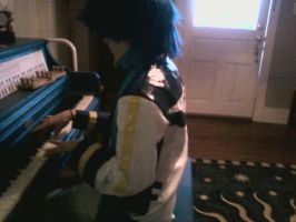 KAITO Playing the Piano by stormilove