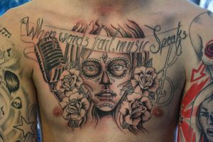 chest tattoo by Unibody