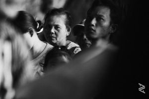 in the middle of a crowd by venario
