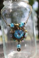 Blue Glow Wire Wrapped Dragon Eye Necklace by TiellaNicole