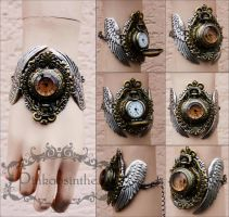 Winged watch cuff I by Pinkabsinthe