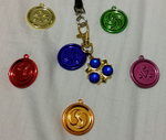 Ocarina of Time Medallions by elfofcourage