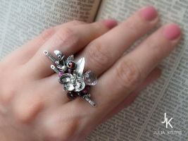Variation of silver orchid ring by JuliaKotreJewelry