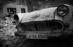 tired old car by hidlight
