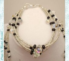 Multi Strand Silver, Black, Iridescent Teardop by TheSortedBead