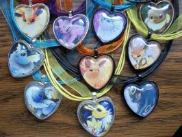 FOR SALE: Eeveelutions Glass Heart Pendants OLD by BlackManaBurning