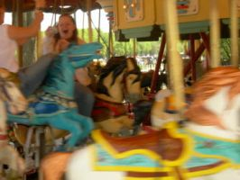 blur of the merry-go-round by OfTheGlassCircus
