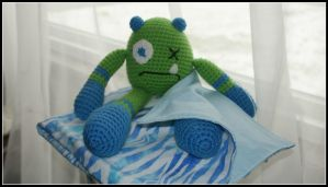 Baby Blanket with Sad Monster by SecondHandCaravan