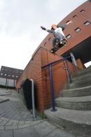 Mitch noseslide over the rail by eddiethink