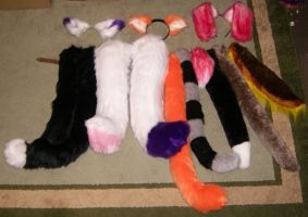 Ears and tails for sale by AcrotomicStudios