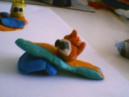 Surfing Puffle from plasticine by LadyOrca