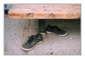 Bench with shoes by godofodd
