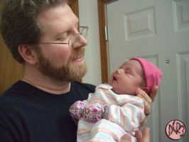 Me holding Myra 14 days old by DCRIII