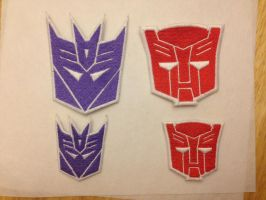 Autobot and Decepticon Emblem patches by ScrwLoose
