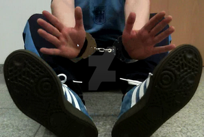 Helpless boyhands caught in police handcuffs. by SneakerBoyBondage