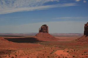 Buttes, sun, shadow, clouds and a lot of space by Dr-J-Zoidberg