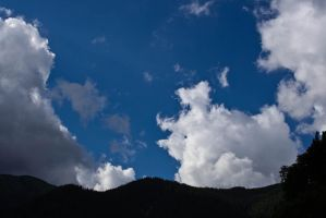 Blue Skies over the Mountains by daniel-skellig