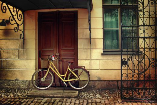 Her yellow bike by Pajunen