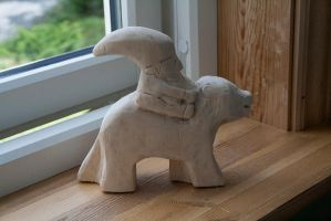 Woodcarved Nisse(Norwegian gnome/goblin) on a bear by Eldharjar