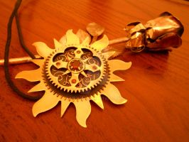 Brass flower and pendant by mpv666
