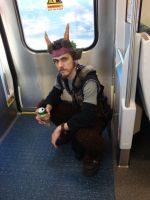 Satyr on train drinking beer by JayelDraco