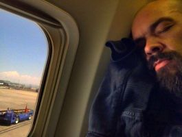 Aaron asleep on plane by MJandGhostAdventures