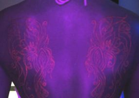 Blacklight wings lit up by artist4life