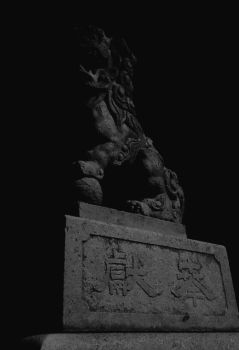 Guardian lion-dog at Shinto shrine by smen1884