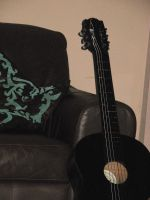 Guitar and a sofa by morana-stock