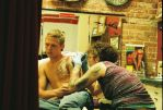 scene from a tattoo parlour by TuNages