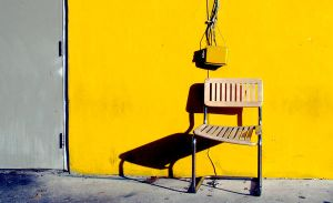 One chair, on yellow by beloit08