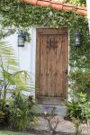 00076 - Bolted Wooden Door with Lanterns and Vines by emstock