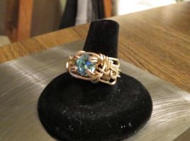 Blue topaz wire wrapped ring by whippetgirl