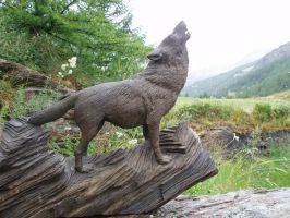 Woodcarver Wolf howling 1 in bog oak by woodcarve