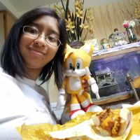 I'm eating my favorite chili cheese dog with Tails by Magic-Kristina-KW