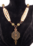 Triple pearls with caged beads by twin-blades