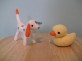 Needle felted dog and ducky. by imaginaryfriends2012