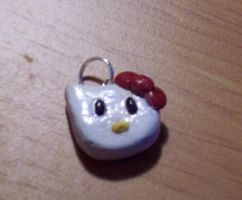 hello kitty charm by BloodStainedSilk