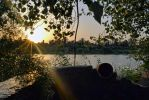 A sunset on an orchard beside the river  . by musi1