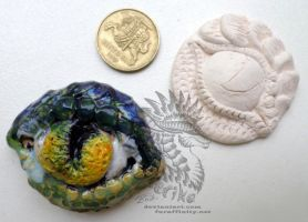 Dragon eyes pendants for 8-15$ by Drerika