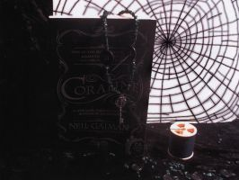 Coraline book and necklace by CrystalEthelstein