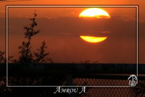 Sunset  through  clouds by AMROU-A
