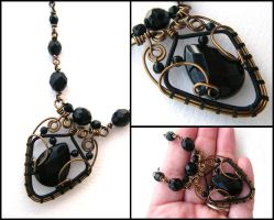 brass and black necklace by annie-jewelry